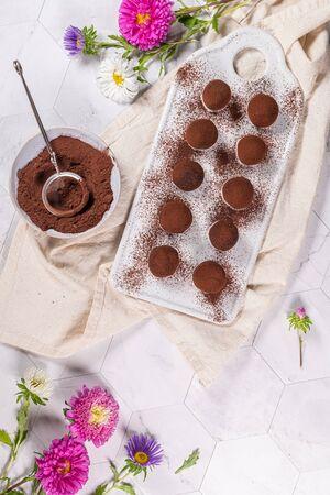 Fine chocolate truffles on white ceramic plate Stock fotó