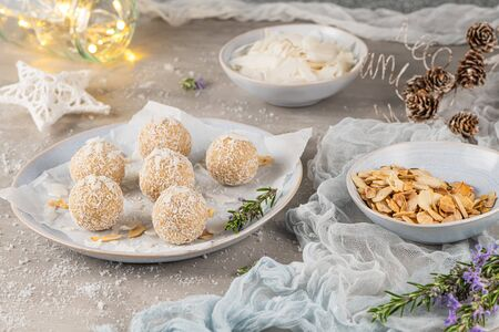Homemade sweet white chocolate and coconut in a plate. Candy - snowball truffles on a Christmas table Stock fotó