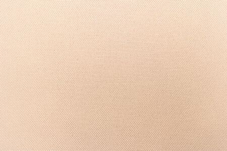 Cream abstract Hessian or sackcloth fabric or hemp sack texture background. Wallpaper of artistic wale linen canvas. Blanket or Curtain of cotton pattern with space for text decoration. Seamless cream