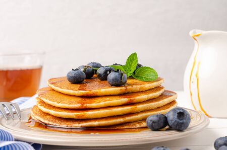 Stack of pancakes with fresh blueberry and caramel syrup