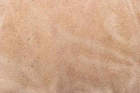 The texture of genuine leather. Impeccable and stylish background. Beautiful stylish background. Natural skin texture close up. Brown background. The structure of the leather material brown shades