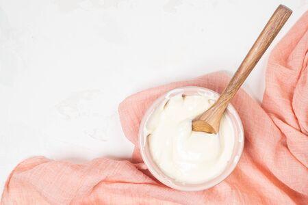 Cake cream. Whipped cream in a bowl. Cream texture. Buttercream texture on top. Making buttercream. Archivio Fotografico