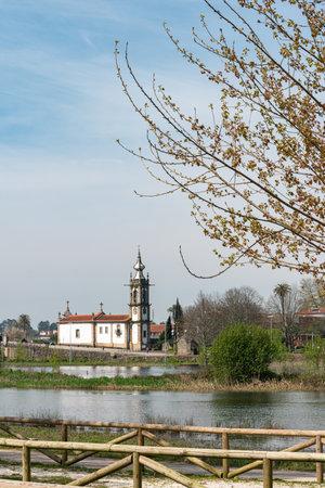 Santo Antonio da Torre Velha church with roman bridge in Ponte de Lima town, Portugal. Stock Photo