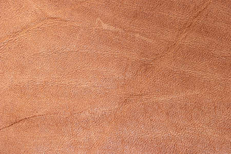 Leather brown background, leather material texture photo.
