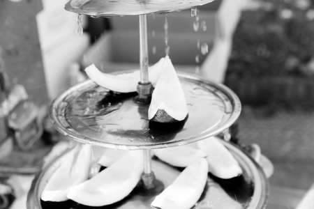 b w: B & W coconut street snacks with dripping water falling over