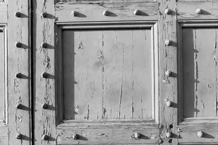 b w: B & W antique wood door with studs Stock Photo