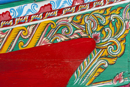 starboard: Colorful pattern of traditional fisherman boats These wooden boats were made and painted by boat makers in south of Thailand  Stock Photo
