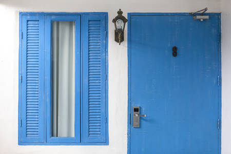 Beautiful blue colored wooden window in a house photo