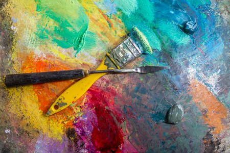 Art palette with oil paints and brushes  theme with paint brushes and palette photo