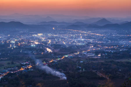 bid: Loei city was evening on Phu Boa Bid viewpoint. Loei Province, Thailand.