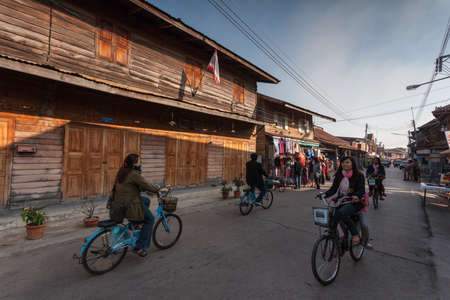 brothel: Chaing Khan,Loei, Thailand. - February,02,2014: Unidentified old house and people on a walking Street  in Chaing Khan,Loei, Thailand. Walking Street is a popular attraction. Almost 20 million tourists visited Thailand .