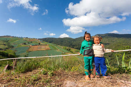 neighbours: Phetchabun province, Thailand - October,27,2012:Hmong  young girls lovely at Phu Tab Berk, Phetchabun province, Thailand.