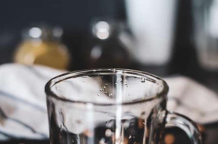 Glass empty mug. Close up. Kitchen interior. Zdjęcie Seryjne
