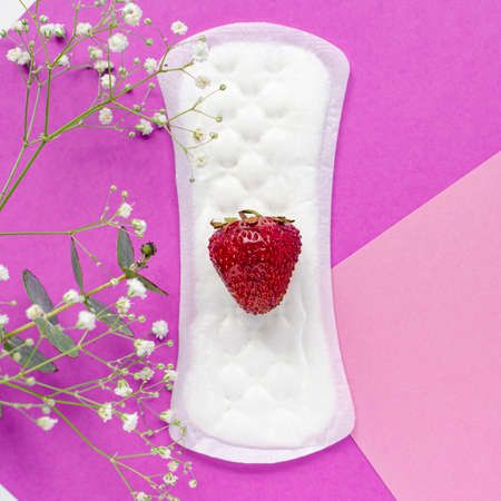 The concept of womens health. Gaskets. Vaginal discharge. Pink background with flowers. Red strawberries. Stok Fotoğraf