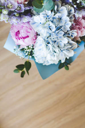 Bouquet of flowers close-up. The view from the top. Standing on the floor, tree. Summer flowers. Peonies, hydrangea and others. Soft focus. Zdjęcie Seryjne