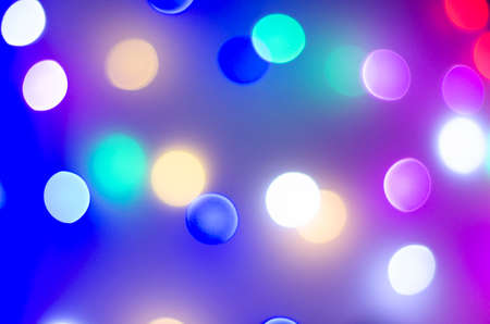 Multi-colored bokeh in neon colors. Good New Year spirit. Bright colours. Blurred focus. Zdjęcie Seryjne - 130643422