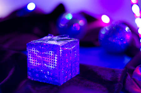 New Years gift. Neon colorful background. Blur Close-up. LED garland. New Year.
