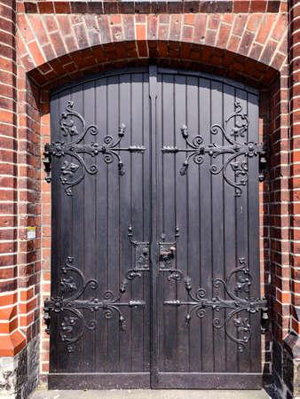 Old beautiful door. Brick building. Steel door. Photo Zdjęcie Seryjne