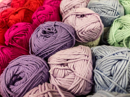 Multi-colored yarn. Different shades. Soft. Shopping for needlework.
