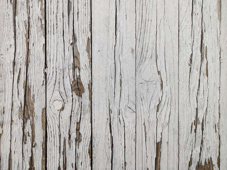 Background white old wooden hedge. Peeling paint. Wood