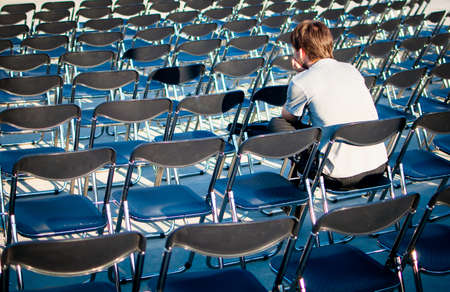 waits: Sitting man waits for the long time Stock Photo