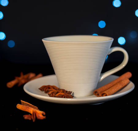 christmas perfume: Cup of tea with cinnamon and anise - black background Stock Photo
