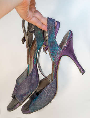 Old training woman tango shoes - totally worn out while dancing Stock Photo