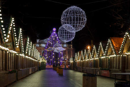 lvov: Night scene - empty Christmas marketplace with decorated small kiosk in Lvov Ukraine