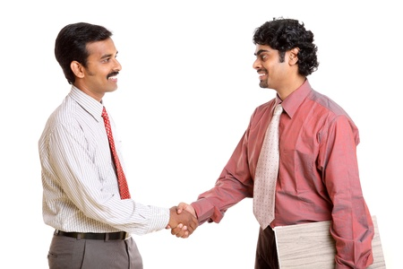 Two Indian business people shaking hands  Stock Photo - 12177227