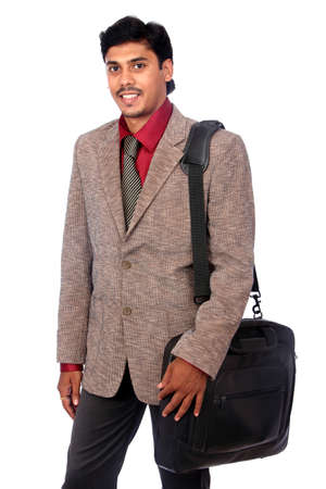 Indian business man with laptop bag on white background. Stock Photo - 12176847