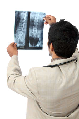 x rays negative: Doctor examining the X-ray over white.