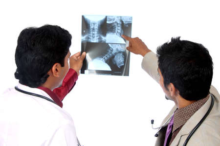 Doctors examining the X-ray over white.  photo