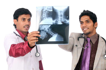 x rays negative: Doctors examining the X-ray over white.