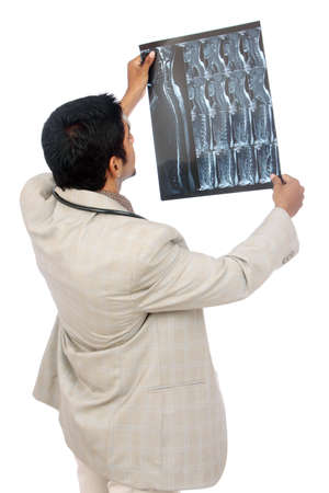 Doctor examining the X-ray over white.  photo