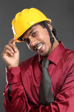 Young indian architect posing to the camera,  photo