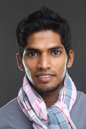 young indian man posing to the camera.  Stock Photo