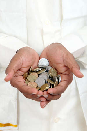 Businessman hand with Indian rupee coins.  photo