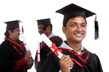 Indian graduates isolated on white background. Stock Photo - 12176649