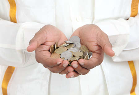 rupee: Businessman hand with Indian rupee coins.