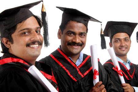 Indian graduates isolated on white background. Stock Photo - 12176634