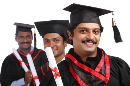 Indian graduates isolated on white background.  photo