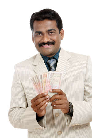 moola: Indian business man with Indian money  Stock Photo