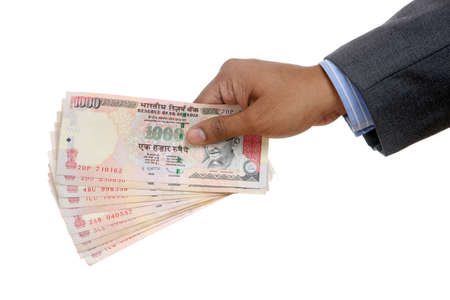 currency exchange: Hand with Indian thousand rupee notes.