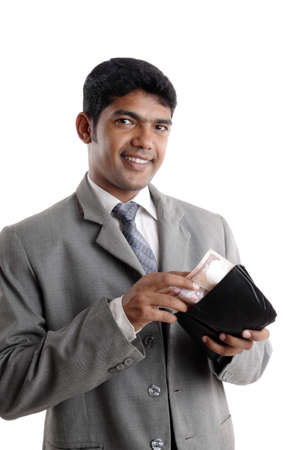 Indian young businessman with money.  photo