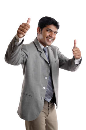thumbsup: Indian young businessman posing on white.