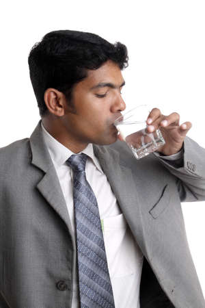 Indian young businessman drinking water. Stock Photo - 12204971