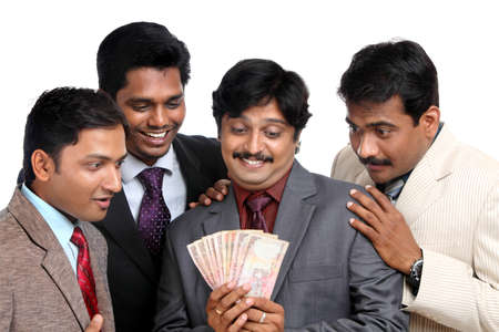 indian money: Indian business people posing to the camera.