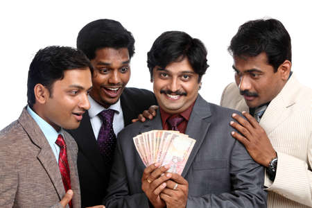 Indian business people posing to the camera.  photo