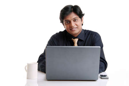 Indian young businessman posing with laptop isolated on white.  photo