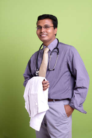 indian professional: Indian young doctor posing to the camera.  Stock Photo
